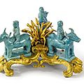 A louis xv ormolu and chinese turquoise glaze porcelain group of three men riding bulls. the ormolu mid-18th century