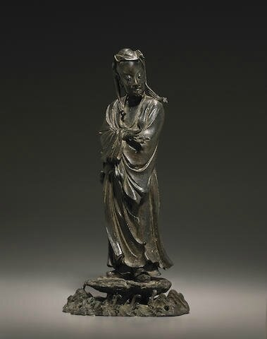 A cast bronze standing figure of an immortal, Ming dynasty, 16th-17th century