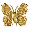 A gold and ruby butterfly clip, by buccellati