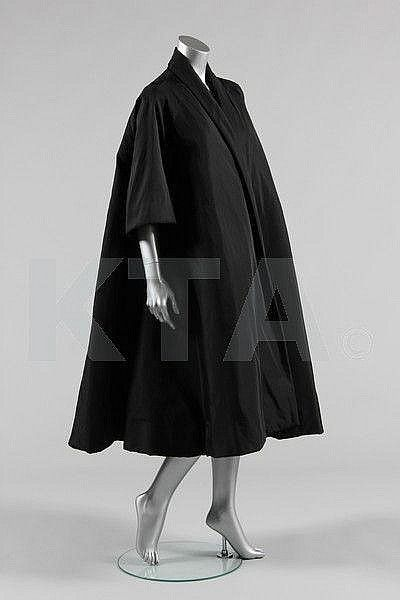 A Balenciaga couture black faille tent coat, 1950s. Photo courtesy Kerry Taylor