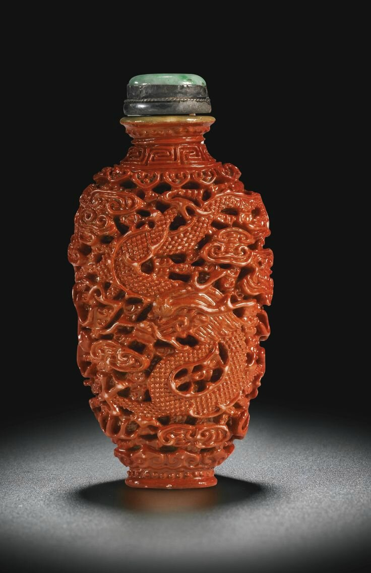 A coral-imitation porcelain snuff bottle, Jiaqing seal mark and period