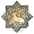A kashan lustre pottery star tile, persia, circa 1300