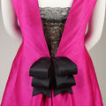 Cristobal Balenciaga. Detail of cocktail dress of fuchsia silk shantung and black lace with black silk satin ribbons, summer 1966