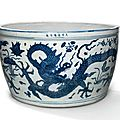 A very rare large blue and white 'dragon and lotus' fish basin, jiajing mark and period (1522-1566)