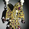 An eagle-shaped gem-set pendant, india, deccan, 18th century,with later pearl chain