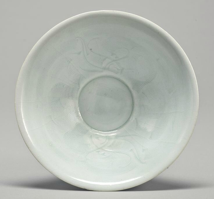 A carved 'Qingbai' 'Twin Fish' dish, Song dynasty