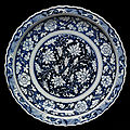 Dish, porcelain painted in underglaze blue with lotus and peony scrolls, China, Yuan dynasty, mid 14th century. 