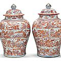 A very large pair of iron-red and underglaze blue jars and covers, first quarter 18th century