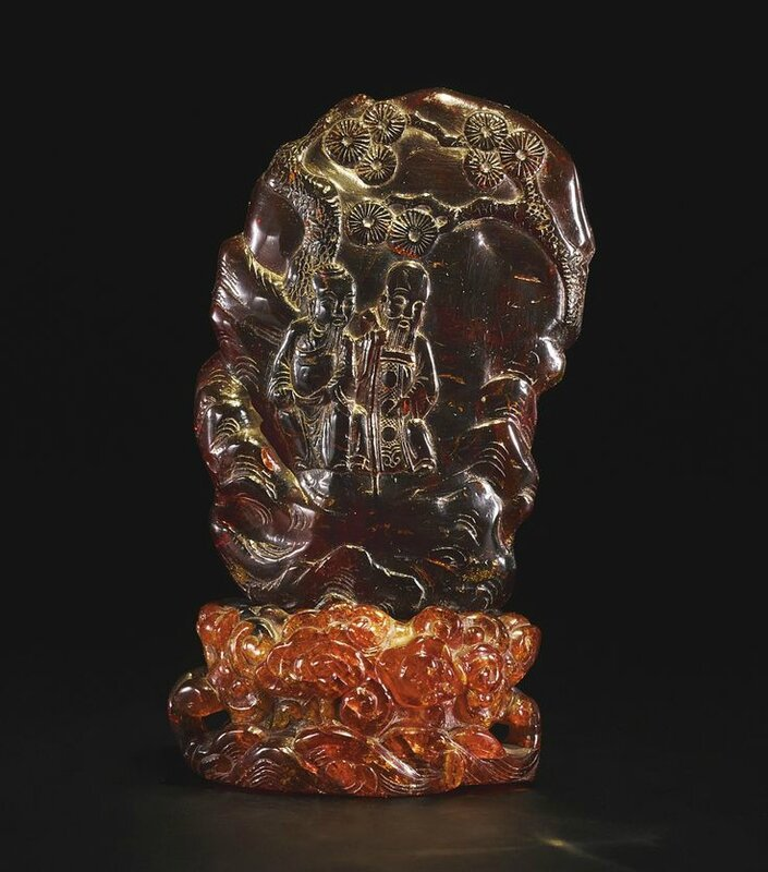 An amber carving and a stand; Stand, Qing dynasty, 18th century; Carving, Qing dynasty, 19th century