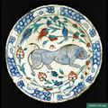 A rare Iznik pottery dish with lion design, Turkey, second half 16th century