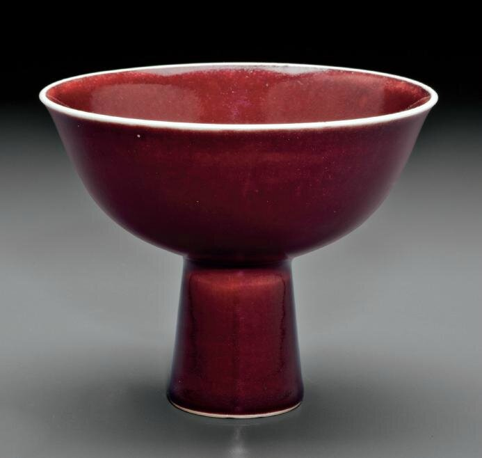 A copper-red-glazed stem bowl, Qianlong six-character seal mark in underglaze blue in a line and of the period (1736-1795)