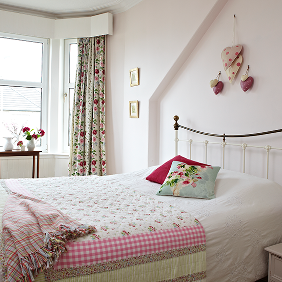 Pale-pink-bedroom-with-floral-accents-Style-at-Home-Housetohome