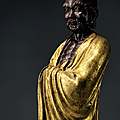 A finely cast parcel-gilt bronze figure of damo, ming dynasty, 16th century