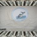 Echange serviette dauphins
