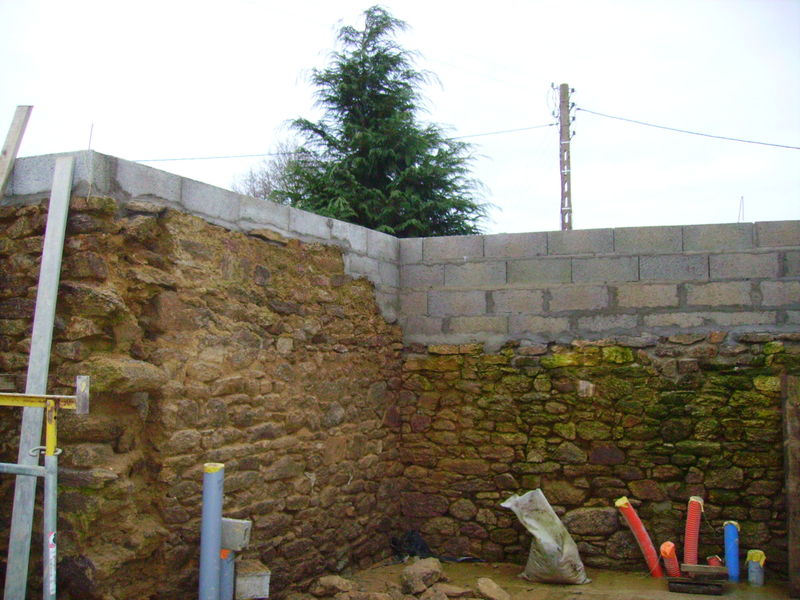 Comment rehausser un mur en parpaing construction maison for Cout construction neuf