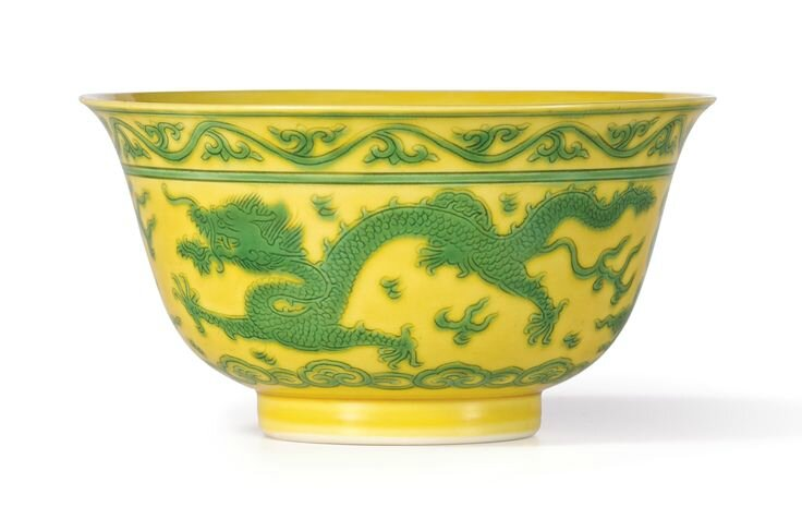 A yellow-ground green-enamelled 'Dragon' bowl, Seal mark and period of Qianlong