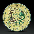 A green and aubergine-decorated yellow-ground dish, 18th-19th century