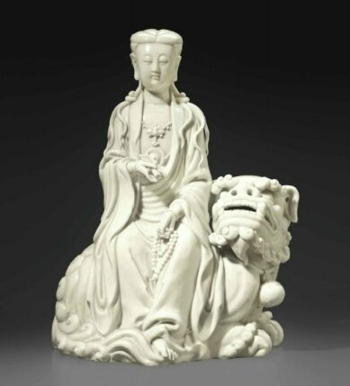 A Dehua figure of Manjushri seated on a lion, China, Qing dynasty (1644-1911)
