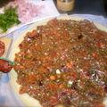 Pizza à la salade de tomates et coriandre