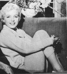 1956_by_jack_cardiff_marilyn_in_sofa_1_1