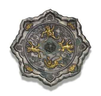 a_rare_parcel_gilt_bronze_octafoil_mirror_tang_dynasty_d5540068h