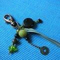 bijou de sac noir et vert
