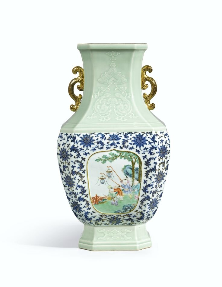 A magnificent carved celadon, underglaze-blue and famille-rose decorated 'Boys' vase, seal mark and period of Qianlong