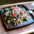 Wilted salad pesto over pasta and aubergines