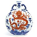 A magnificent and extremely rare iron-red and underglaze-blue 'dragon' moonflask, seal mark and period of qianlong