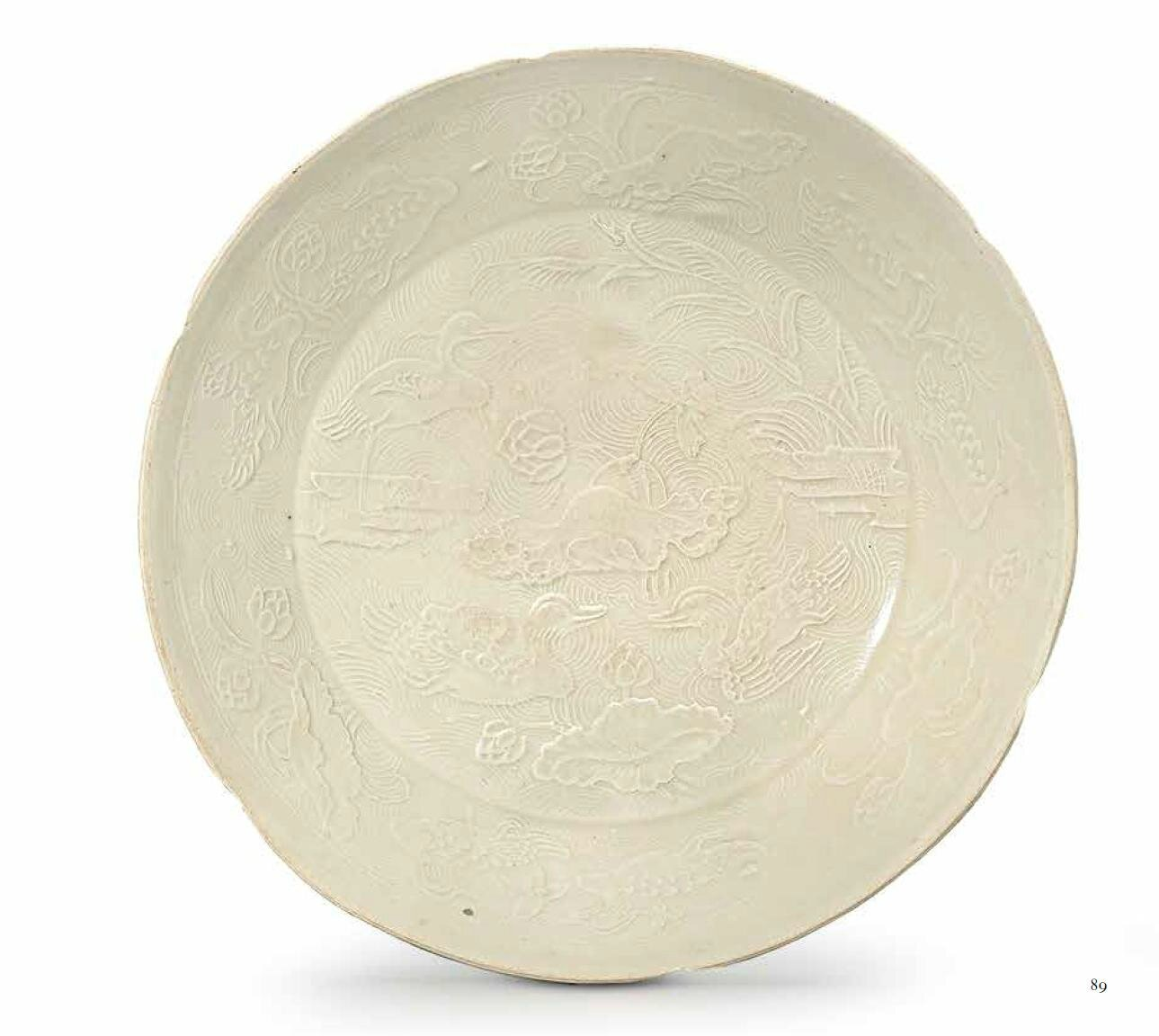 A moulded Ding 'lotus pond' foliate dish, Jin dynasty (1115-1234)