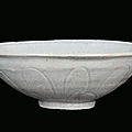 A white engraved earthenware qingbai bowl decorated with petals, china, song dynasty (960-1279)