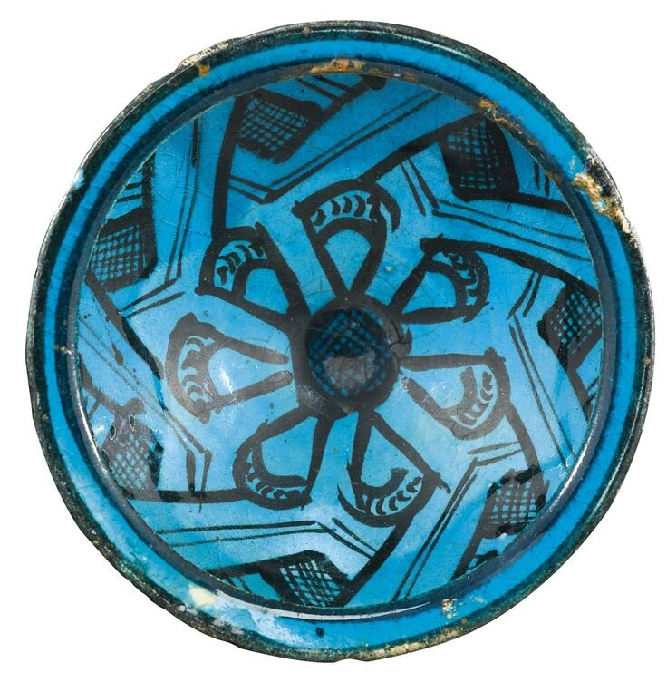 A Kashan black and turquoise bowl, Persia, circa 1200