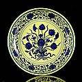 An Imperial yellow-ground blue and whit, lotus bouquet dish, China, underglaze blue six-character mark and period of Yongzheng