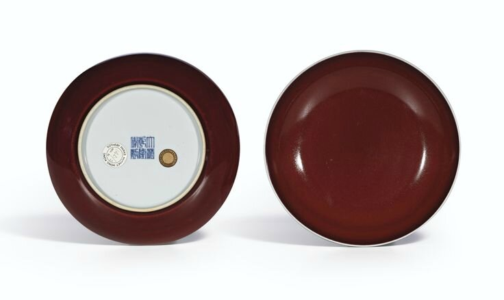 A fine pair of copper-red glazed dishes, Seal marks and period of Qianlong