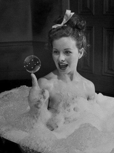 peter-stackpole-actress-jeanne-crain-taking-bubble-bath-for-her-role-in-movie-margie
