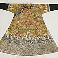 A chinese embroidered yellow ground silk dragon robe, 20th century