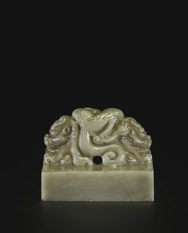 A pale celadon jade seal with inscription 'HUANG TANG SHOU MING ZHI BAO', probably Ming dynasty