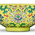 A rare yellow-ground 'yangcai' 'lotus' bowl, qianlong seal mark and period (1736-1795)