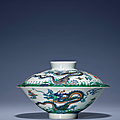 A doucai conical 'Dragon' bowl and cover, Yongzheng six-character marks in underglaze blue within a double circle and of the period (1723-1735)