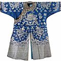 A blue-ground silk brocade nine-dragon robe,china, late qing dynasty