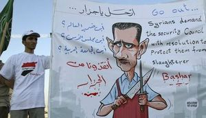 824449_syrian-protesters-hold-a-poster-which-shows-cartoon-images-depicting-syrian-president-bashar-al-assad-during-a-demonstration-in-front-of-the-syrian-embassy-in-amman