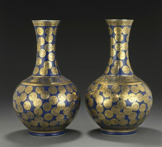 A pair of blue glazed bottle vases with gilt medallion decorations, Guangxu six-character marks and of the period