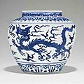 A very rare blue and white 'dragon' jar. Jiajing six-character mark in underglaze blue within a double circle and of the period 