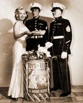 1953_December_Marilyn_attended_the__Toys_for_Tot_Campaign__sponsored_by_the_US_Marines_Corps_in_order_to_collect_toys_for_underprivileged__children