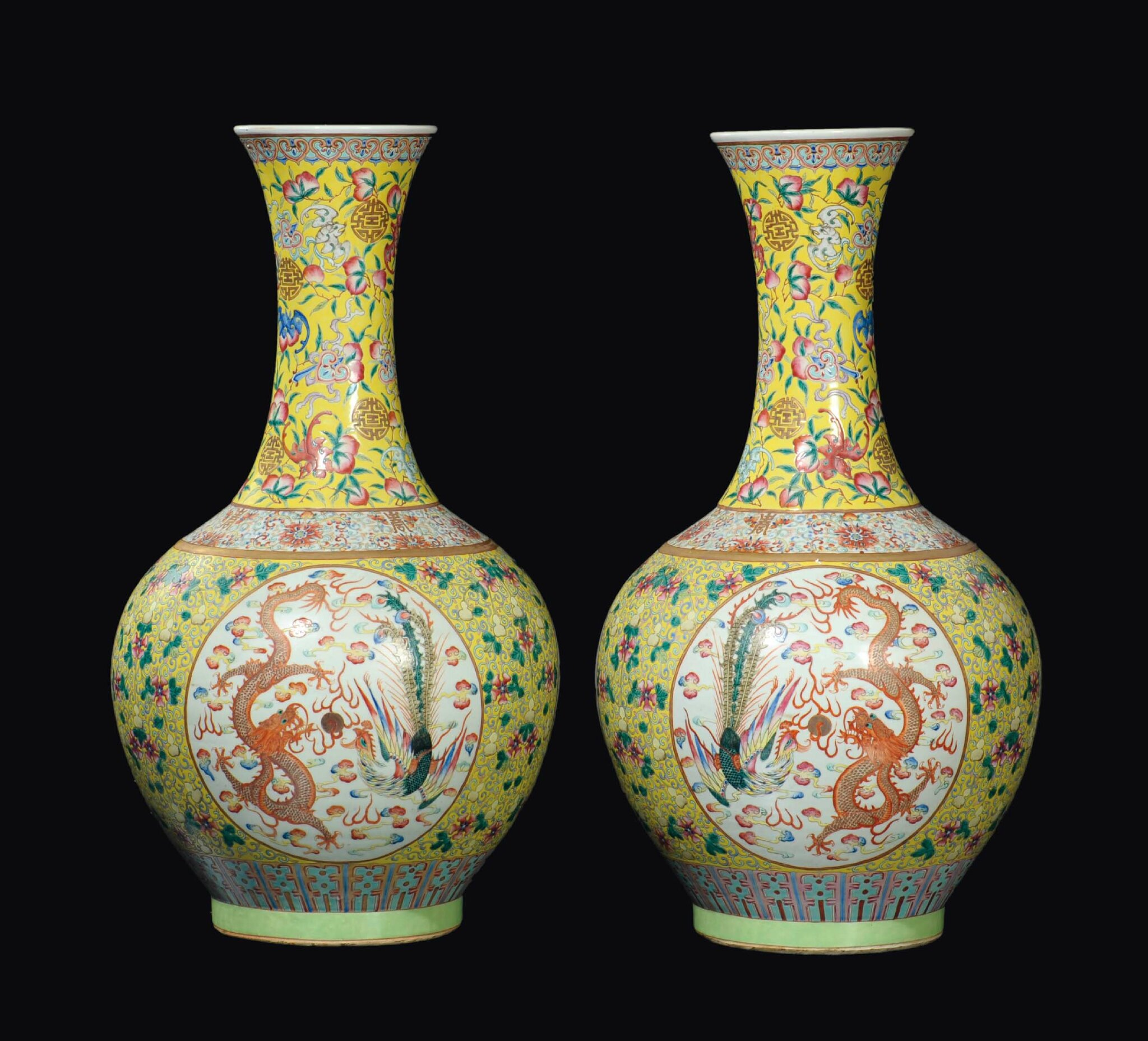 A large and important fine pair of yellow-ground porcelain bottle vases, Qing Dynasty, Guangxu Mark and Period