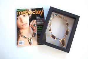 MetalClay_Artist_Magazine_Cover_April 2013_Ricochets_Necklace_Bronze_and_Pebbles_Angela_B_Crispin