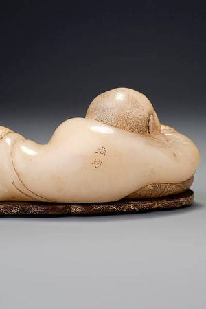A_carved__bai_furong__recumbent_figure_of_Maitreya__by_Zhou_Bin3