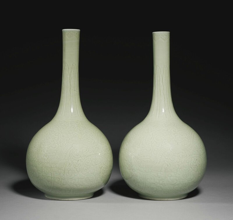 A fine pair of carved celadon-glazed 'chilong' bottle vases, Qing dynasty, Kangxi period