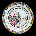 Plate, porcelain painted with overglaze enamels in the famille rose palette and gilt, with a Watteauesque scene. Qing dynasty