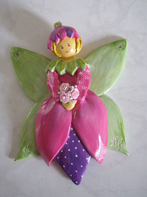 Fée papillon rose